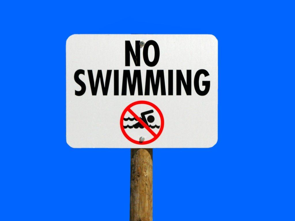 No Swimming sign board